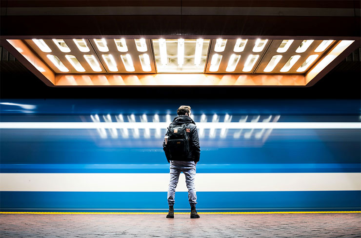 Man watching train pass