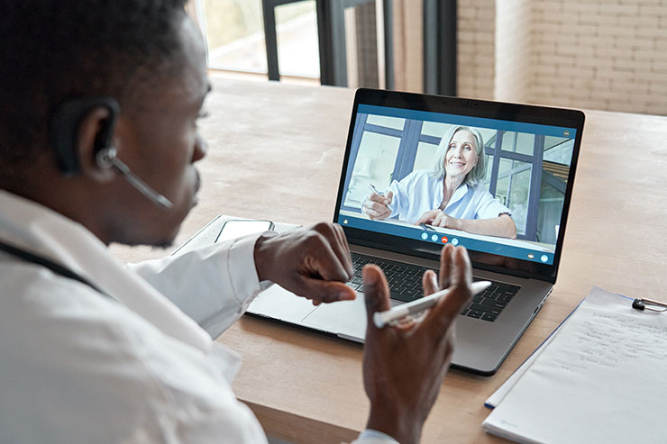 Two people in a virtual meeting
