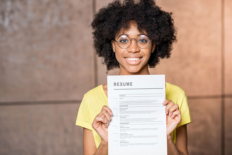 Young woman holding resume
