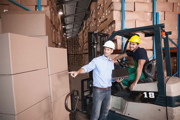How to become a forklift operator: Warehouse manager talking with forklift driver