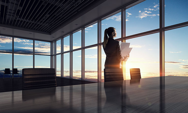 Person looking out window of office building: how to resign