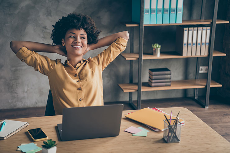 Person sitting at desk smiling