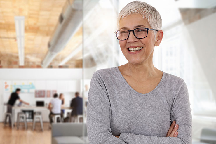 Jobs after retirement: smiling business woman in an office