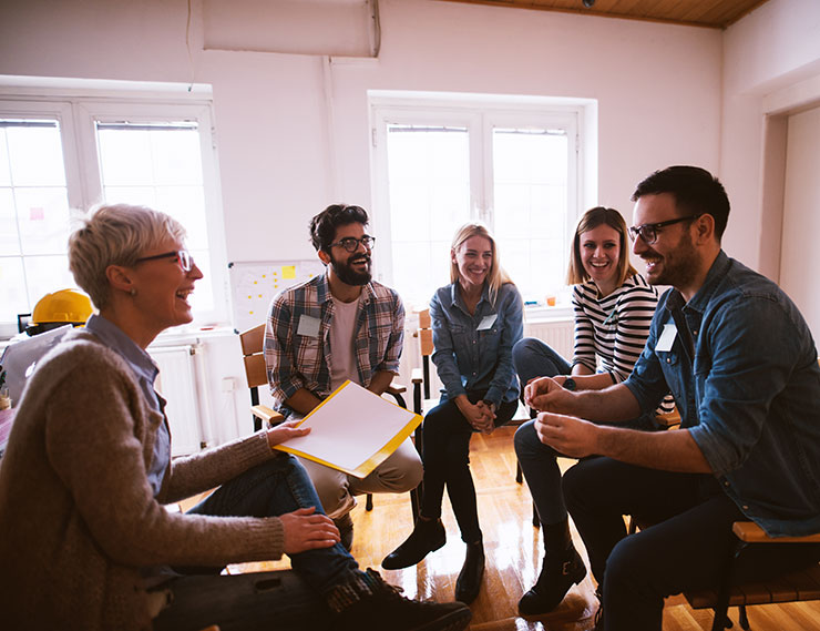 mental health at work: group of people laughing at work