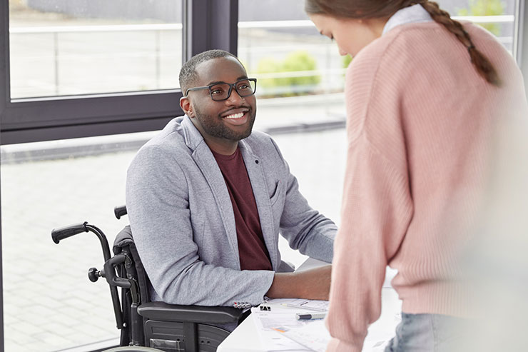 Worker in wheelchair at office
