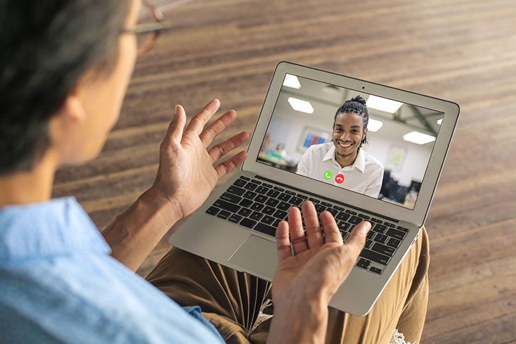 Virtual employee onboarding: colleagues having a conference call