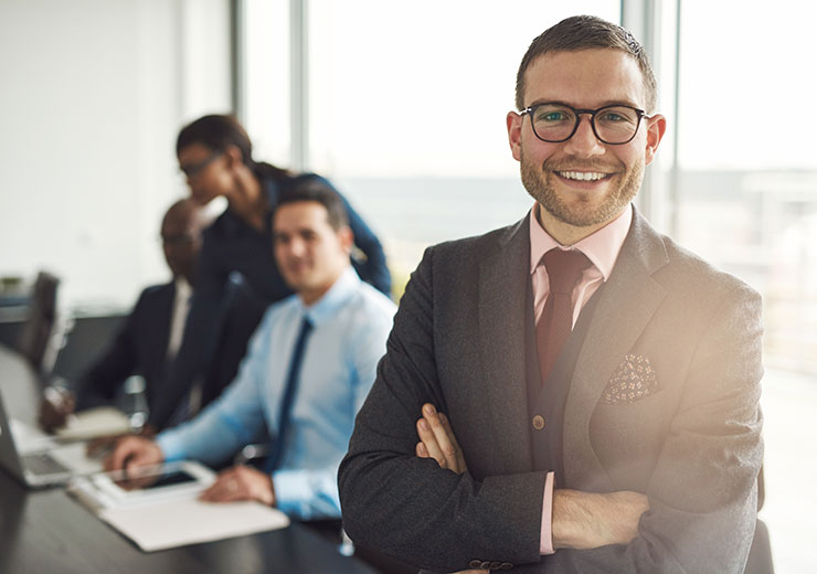 Confident business executive with folded arms